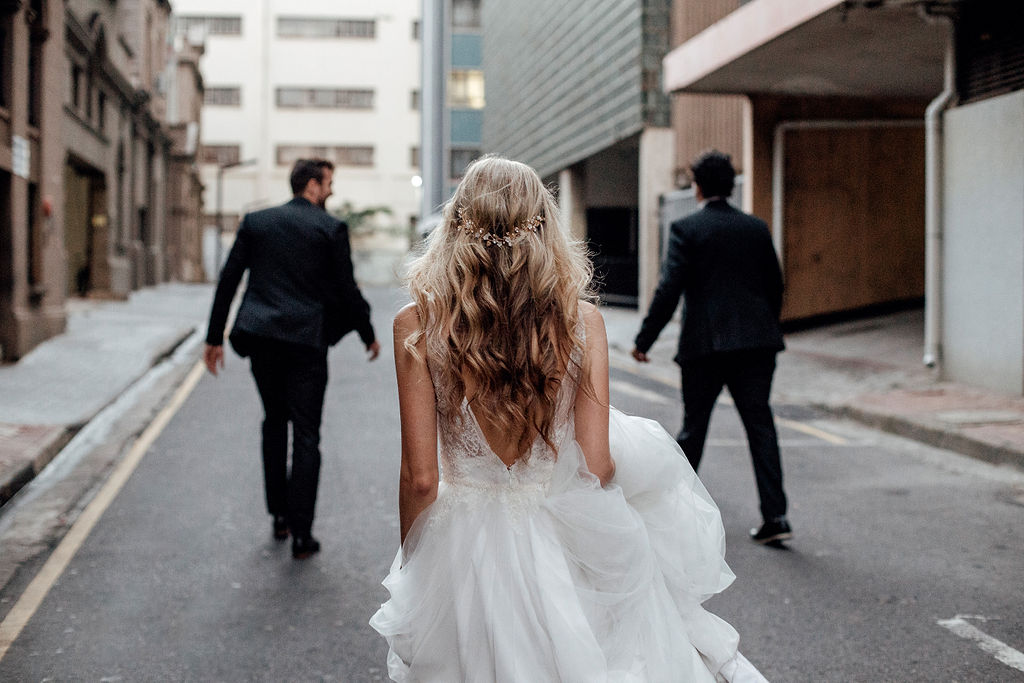 Bohemian bride walking up road with beautiful hairpiece and natural waves in her hair