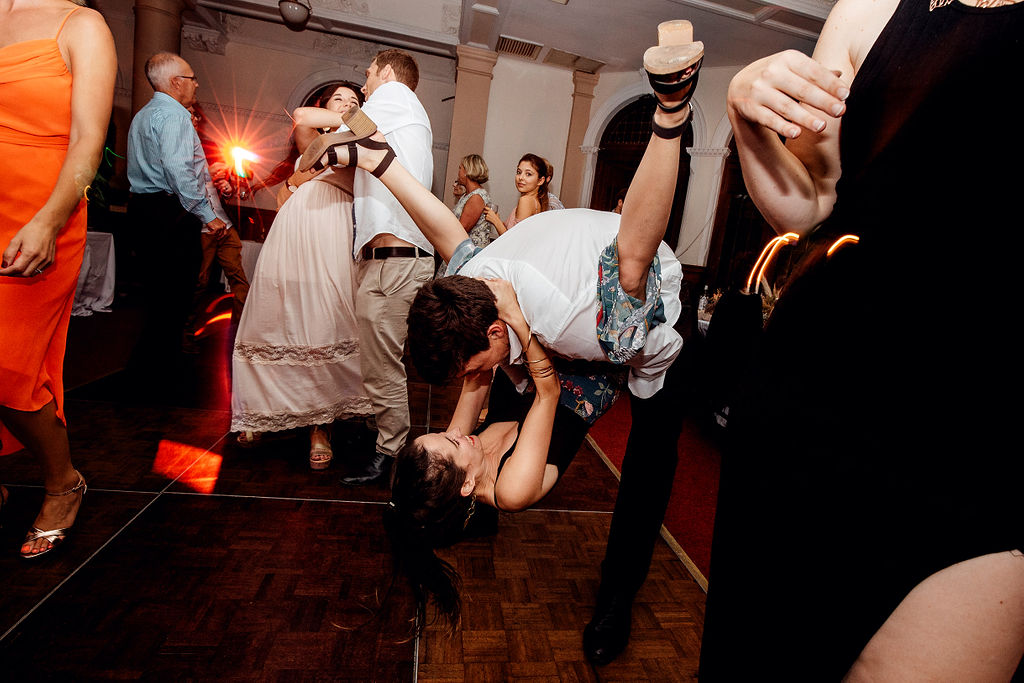 Two wedding guests on dancefloor dancing together and pulling crazy moves