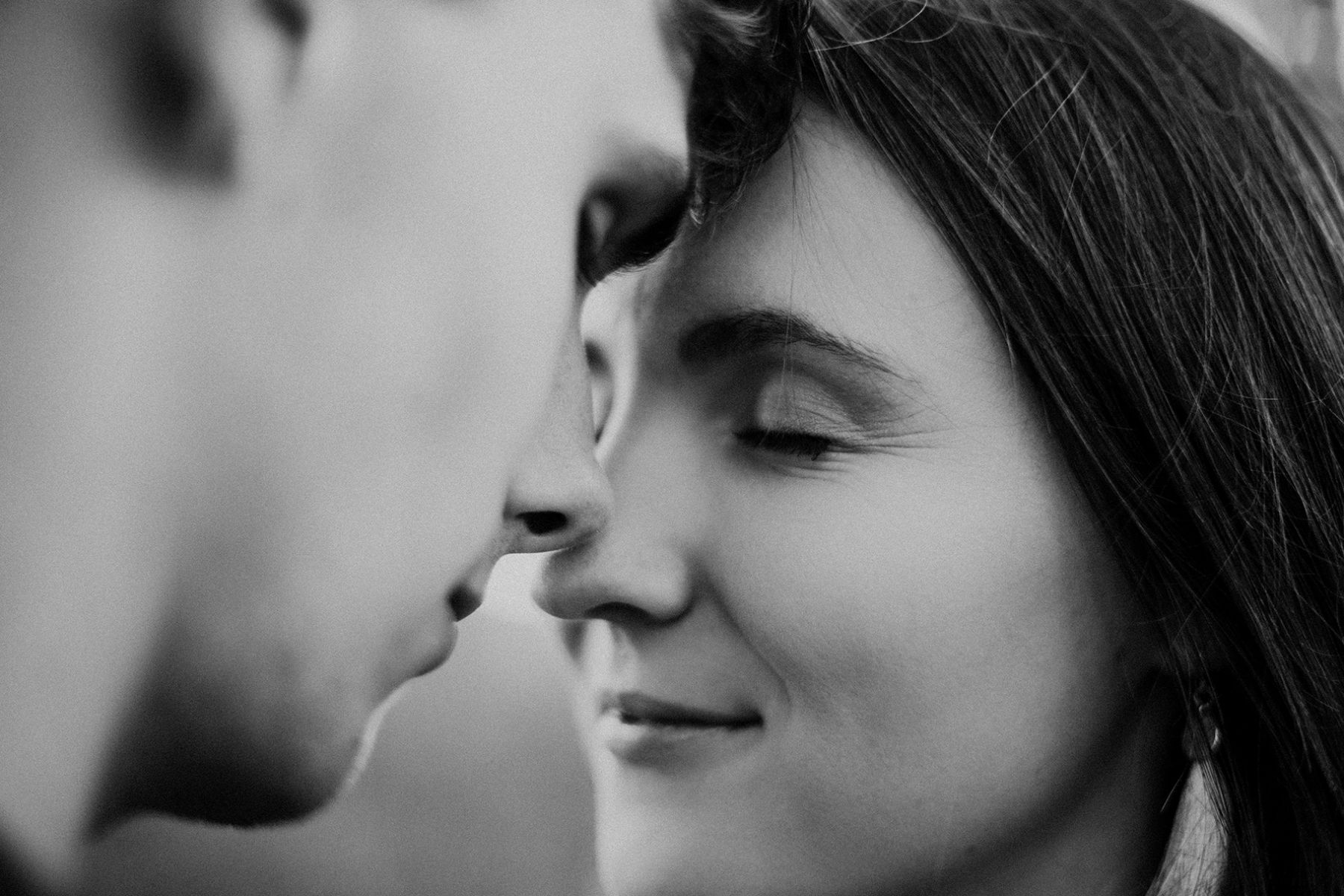 Ethereal close up image of couple intimately touching noses about to kiss for couple shoot portfolio